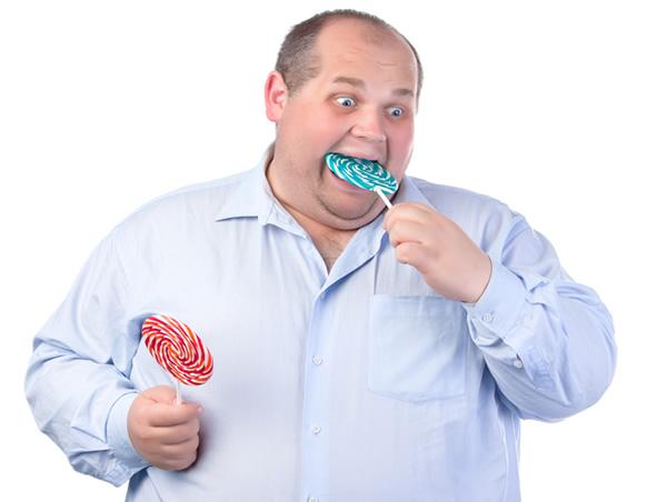 [Image: fat-man-eating-candy.jpg]